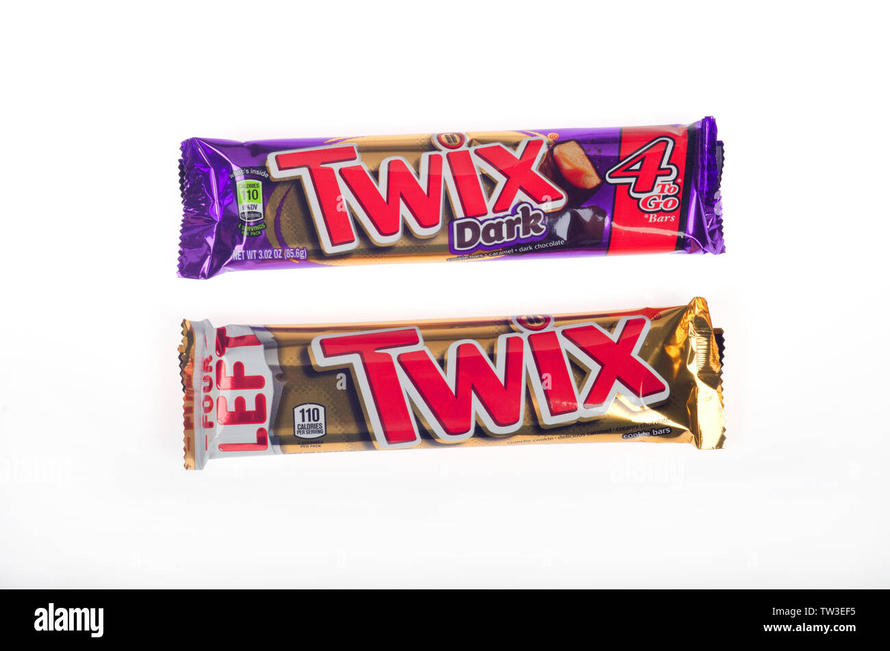 Twix and Twix Dark Chocolate 4 pack candy bars in wrapper made by Mars Wrigley isolated - Stock Image