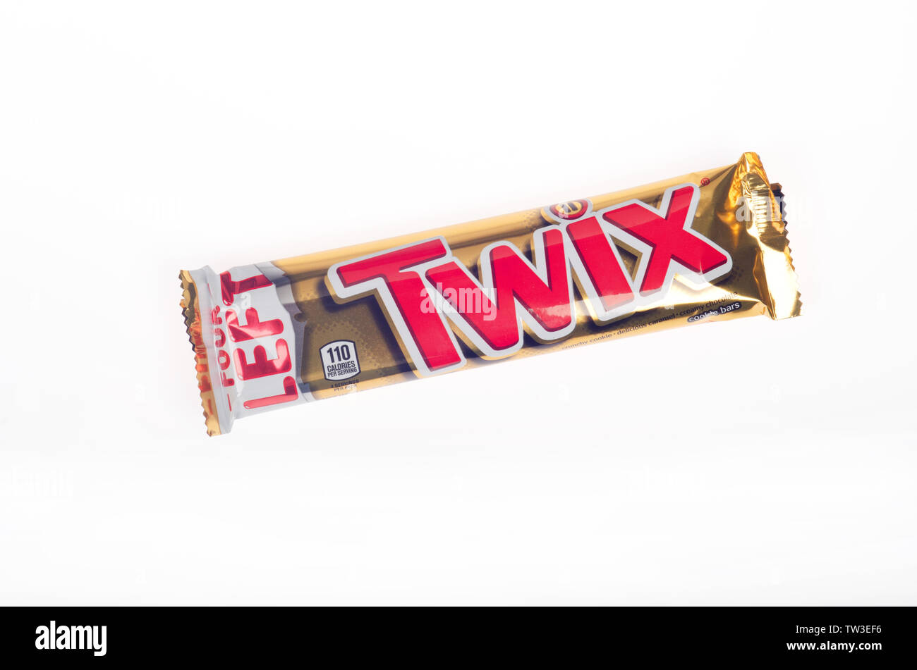 Twix candy bar in wrapper from Mars Wrigley on white background - Stock Image