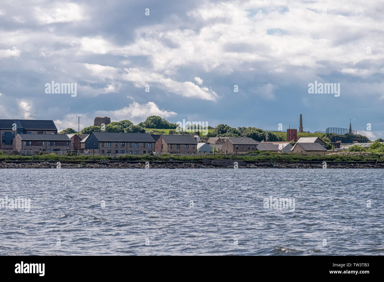 From Ardrossan foreshore looking up to Canon Hill or Castle Hill in Ardrossan. - Stock Image