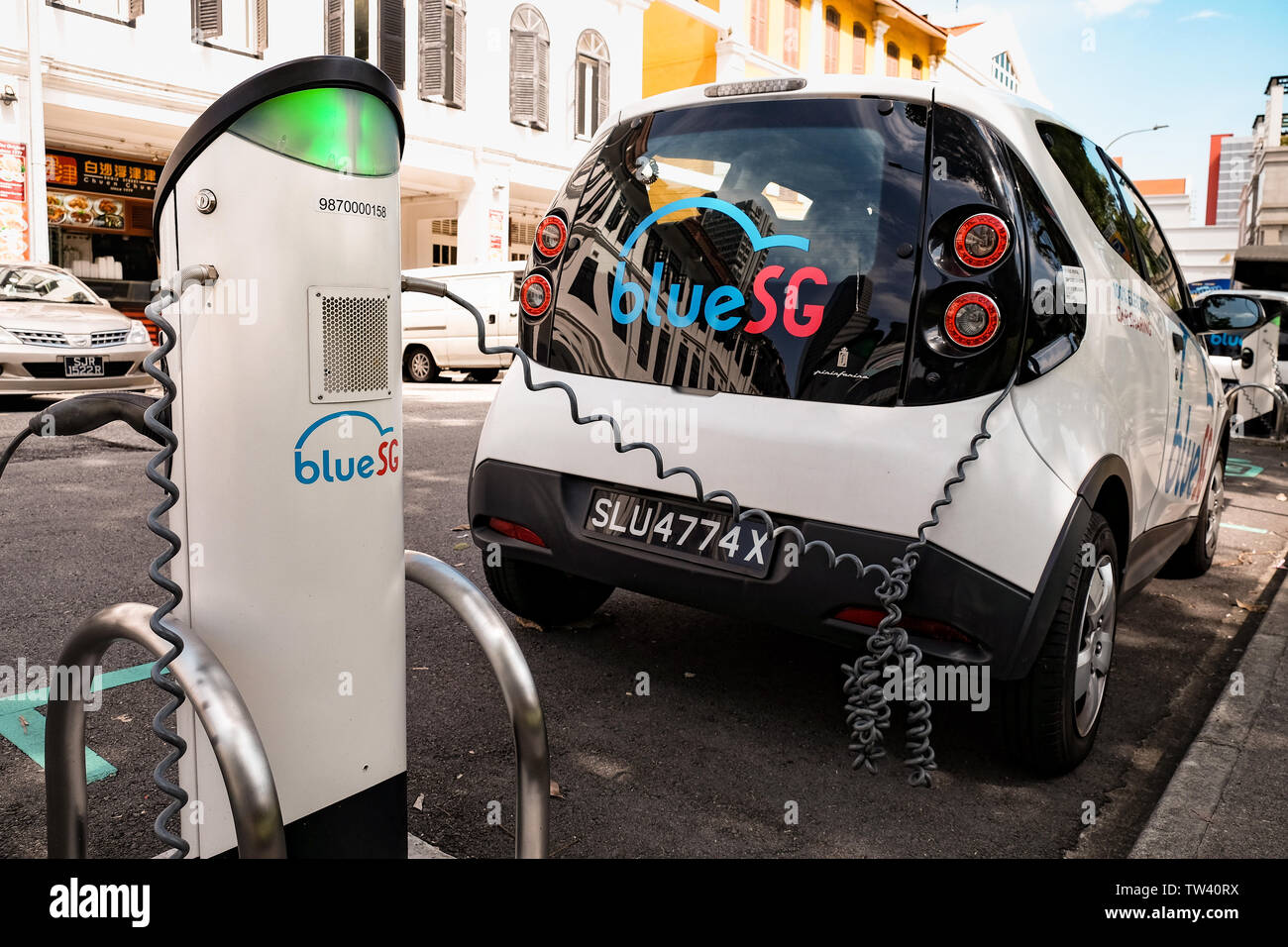 Blue SG electric car sharing scheme in Singapore with charging stations offering a clean pollution free  point to point transport network. Stock Photo