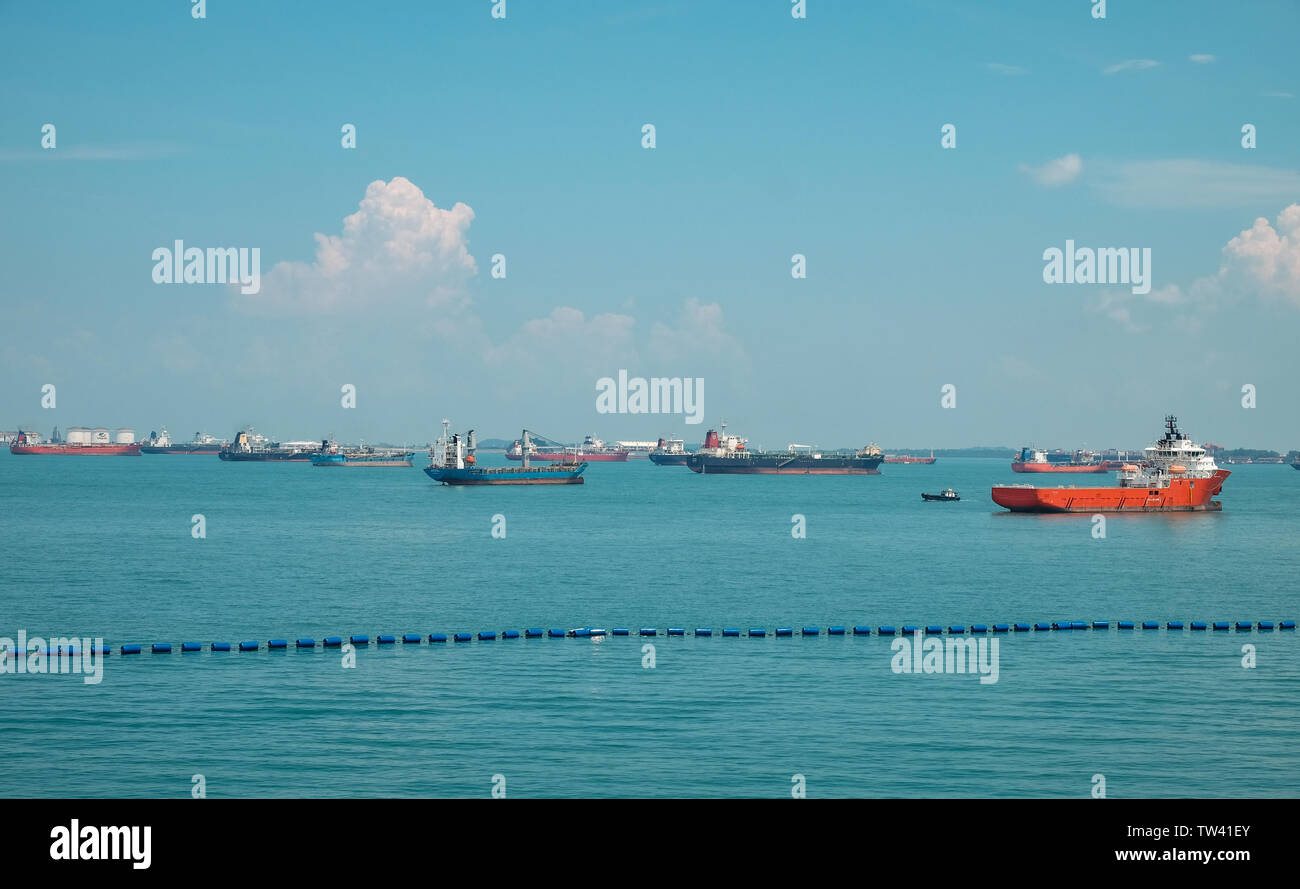The scene of the Vast number of Tanker ships moored of off Sentosa island Singapore - Stock Image