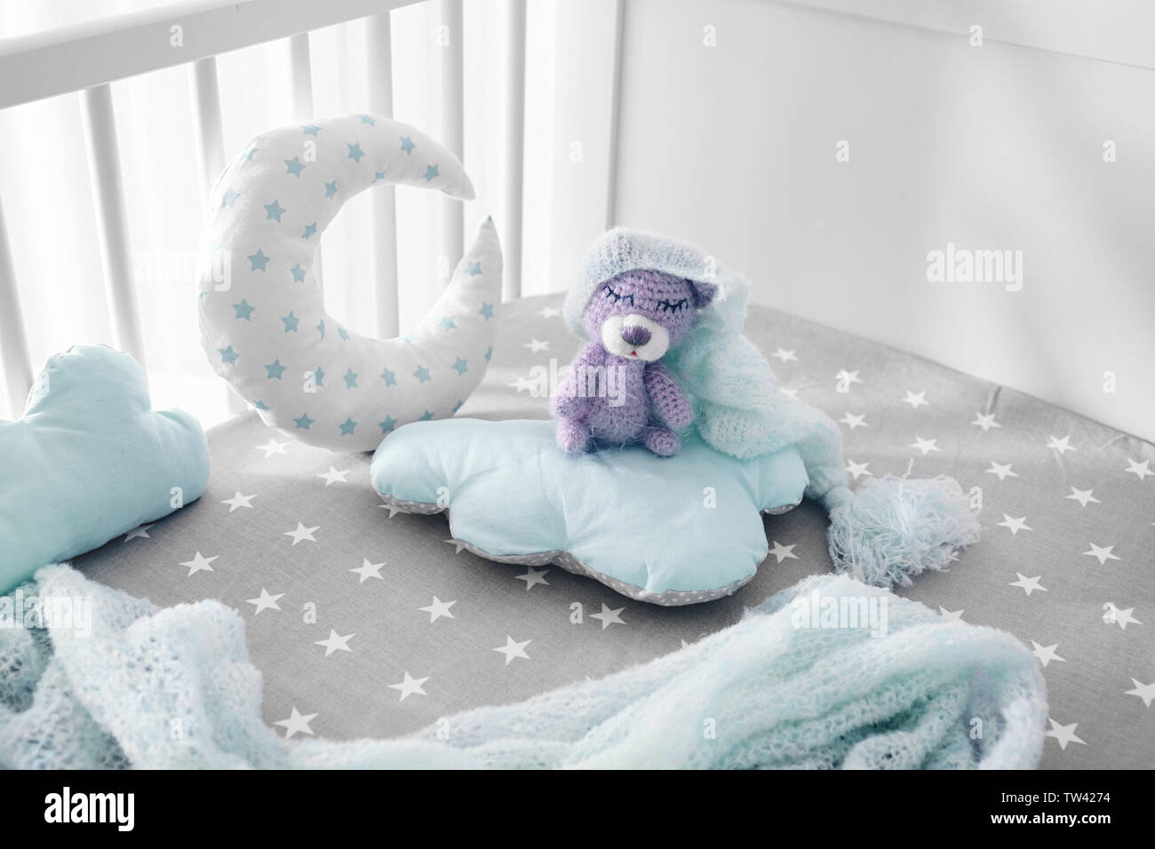 Adorable Handmade Crochet Bear Toy With Baby Clothes And Pillows In Crib Stock Photo Alamy
