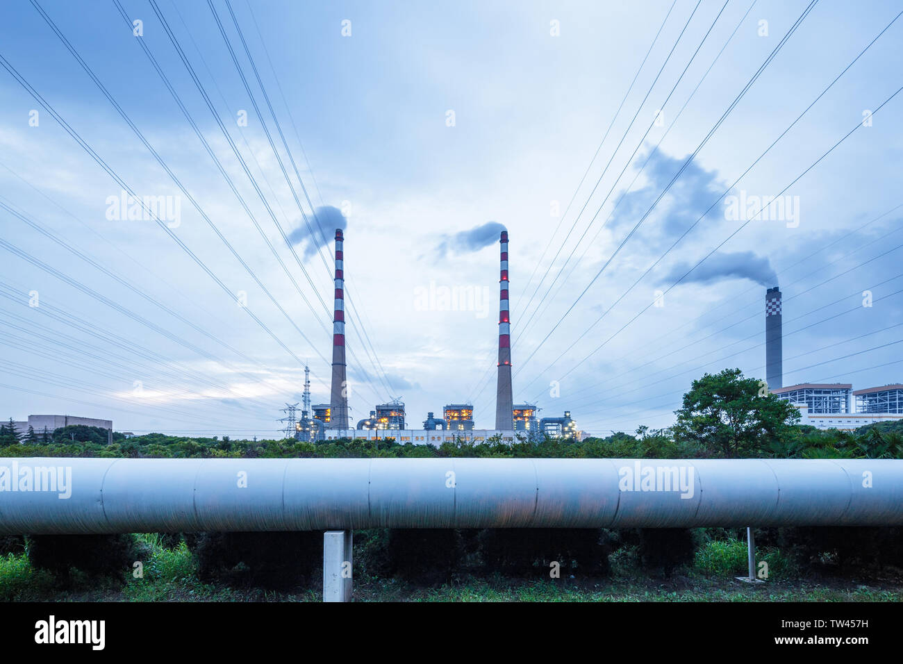 thermal power station letting off pollution at dusk - Stock Image