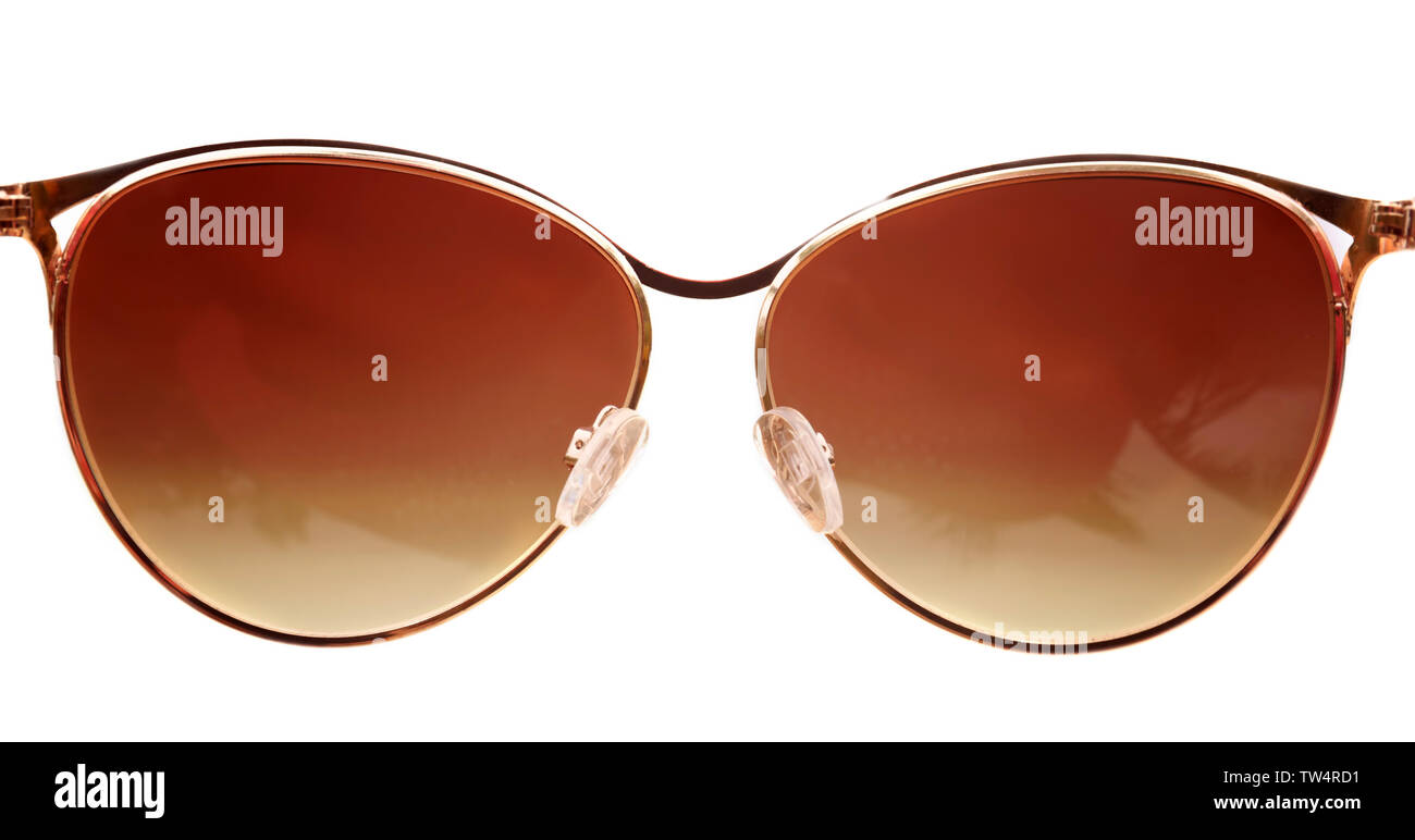 Modern sunglasses on blurred background. Summer vacation concept - Stock Image