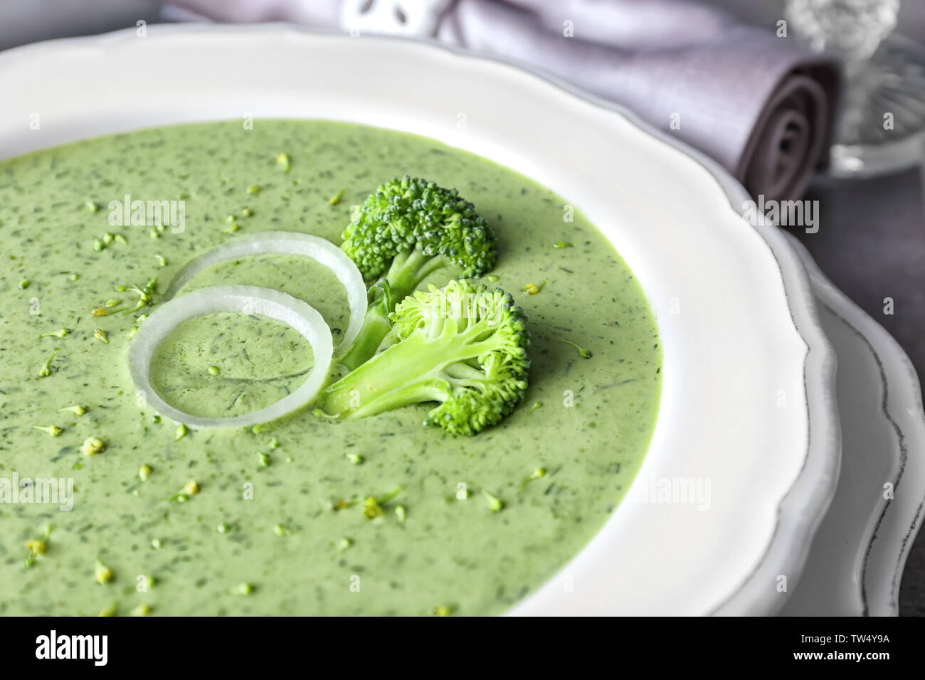 Plate with delicious broccoli cheese soup, closeup - Stock Image