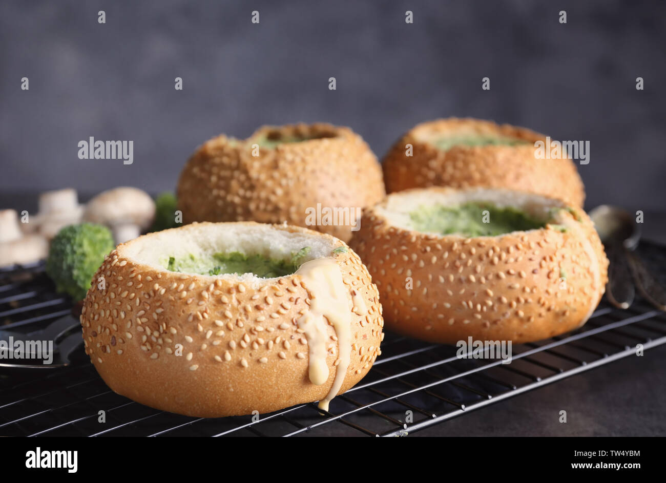 Broccoli cheese soup in bread buns on cooling rack - Stock Image