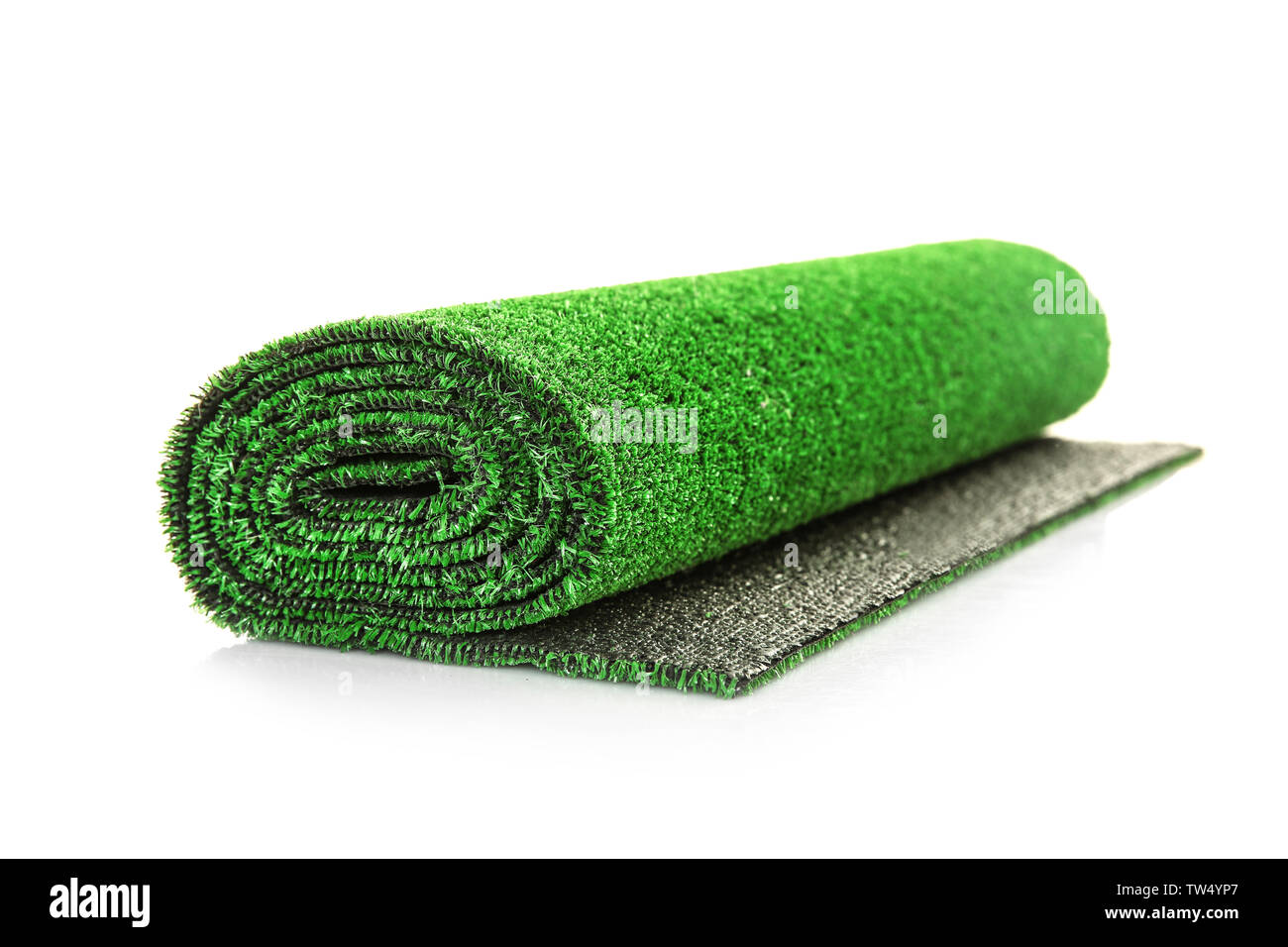 Roll of artificial grass mat on white background Stock Photo