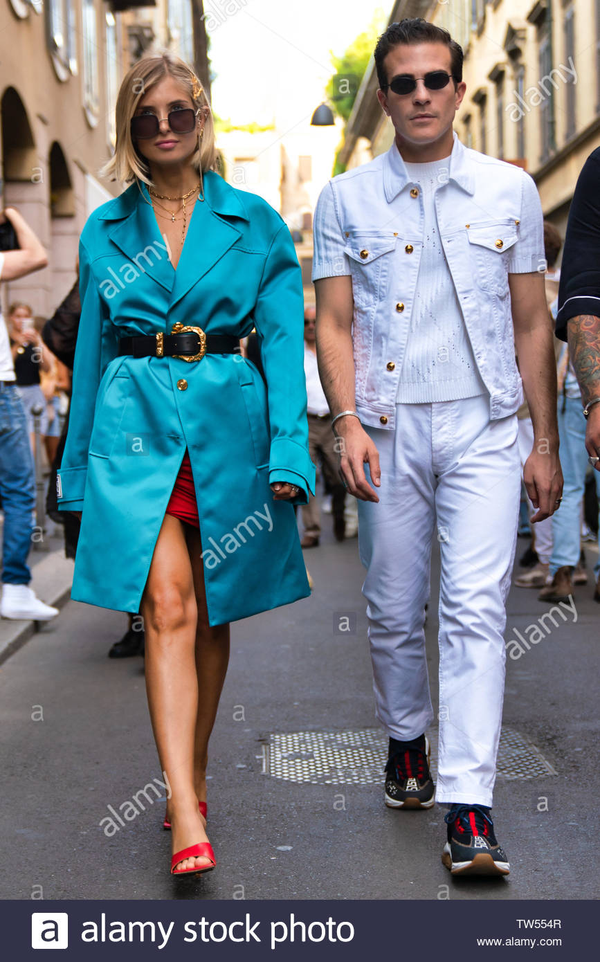 MILAN, ITALY - JUNE 15: Xenia Adonts is seen wearing coat and Carlo Sestini outside Versace during the Milan Men's Fashion Week Spring/Summer 2020 on June 15, 2019 in Milan, Italy. - Stock Image