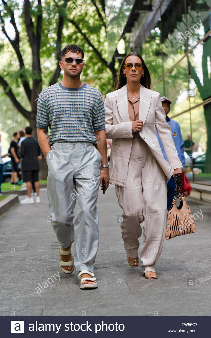 MILAN, ITALY - JUNE 15: Couple Jean-Sebastian Rocques and Alice Barbier seen outside Emporio Armani during the Milan Men's Fashion Week Spring/Summer 2020 on June 15, 2019 in Milan, Italy - Stock Image
