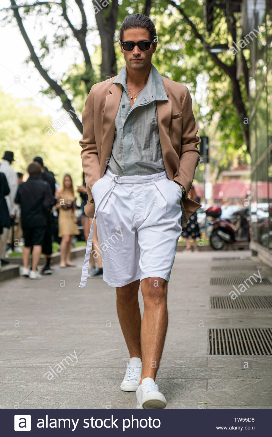 MILAN, ITALY - JUNE 15: Marc Forne is seen wearing white shorts, brown blazer outside Emporio Armani during the Milan Men's Fashion Week Spring/Summer 2020 on June 15, 2019 in Milan, Italy - Stock Image