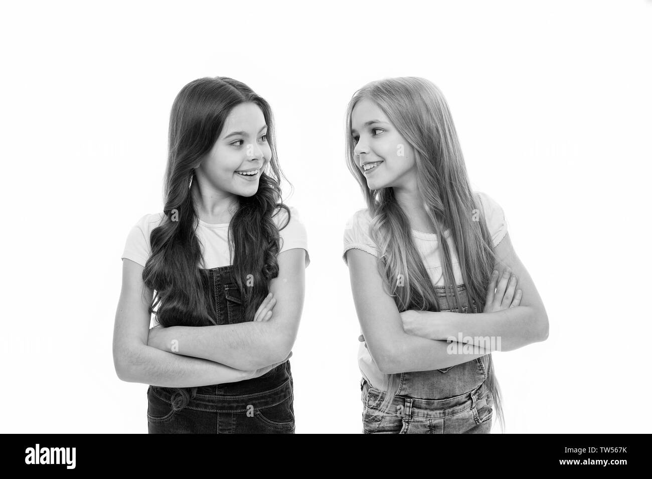 Sisterhood goals. Sisters little kids isolated white background. Sisterly relationship. Sisterhood happiness and issues. Girls confident sisters. Sist - Stock Image