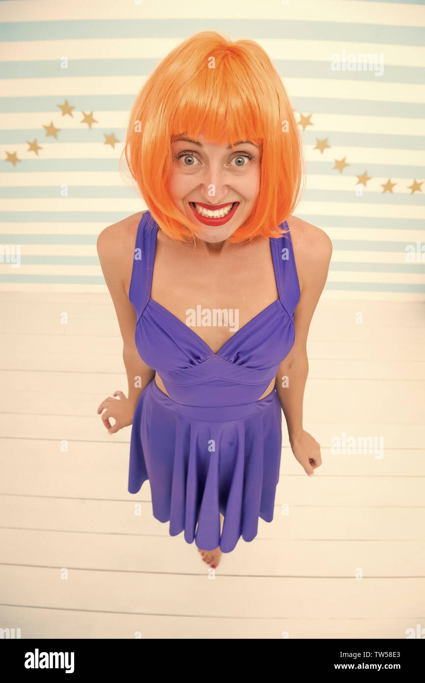oops i did it again. emotions and feeling of crazy girl. i am so sorry. oops. crazy girl made a mistake and is sorry about that. shy woman with orange hair looks very fashionable Stock Photo