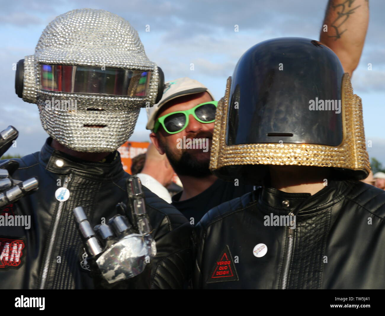 Newport, Isle of Wight. June 16 2019. Isle of Wight Festival - Human Robots duo with biker helmets showing off their attire nouveau costumes. Stock Photo