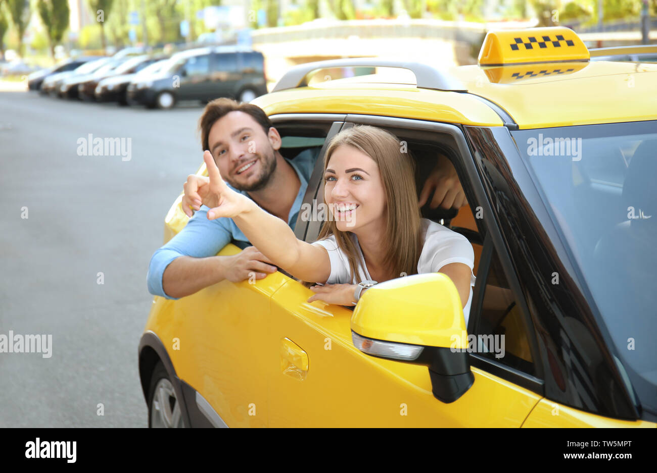 Young couple sitting in taxi car - Stock Image