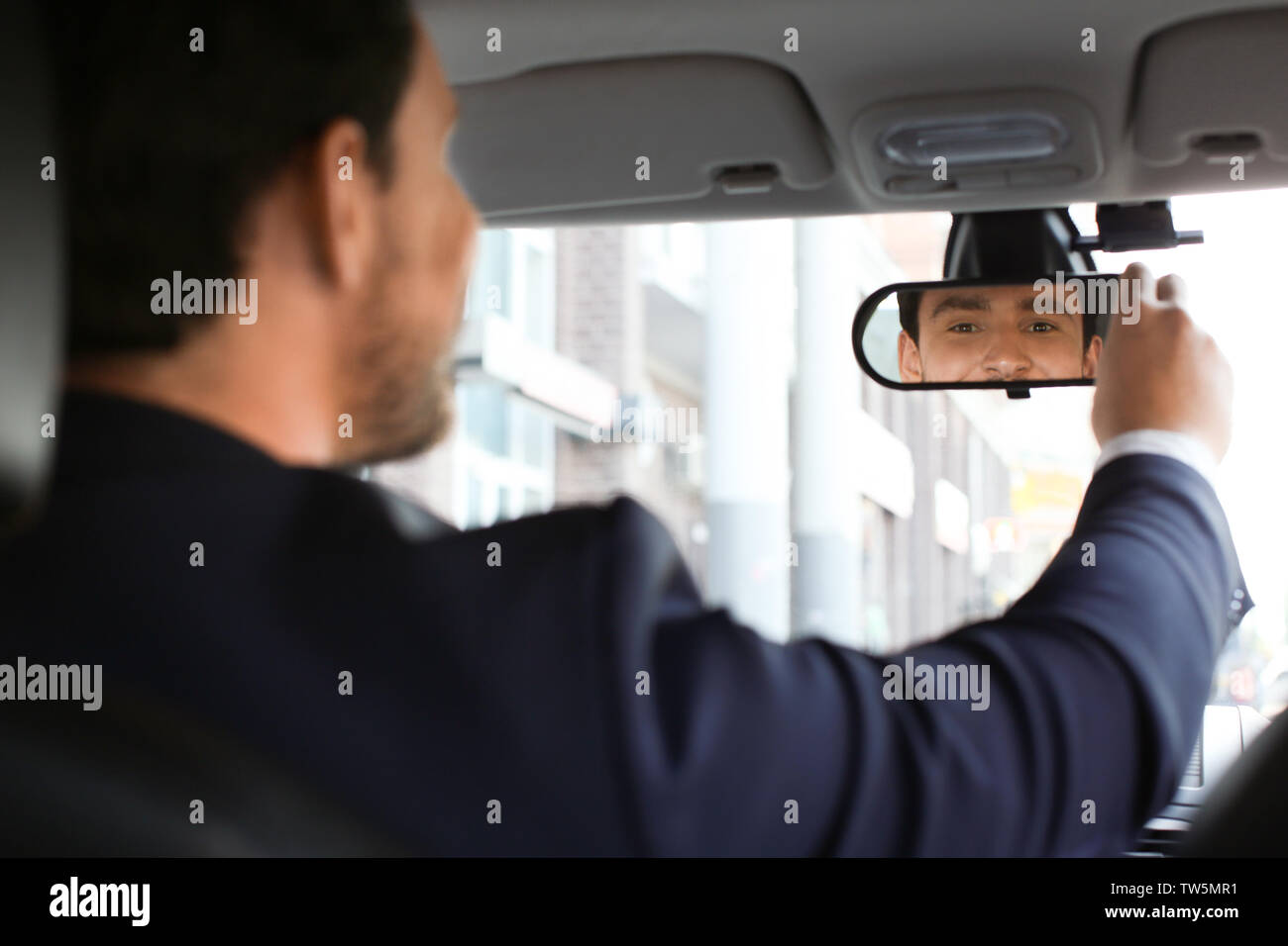 Handsome male driver in car - Stock Image