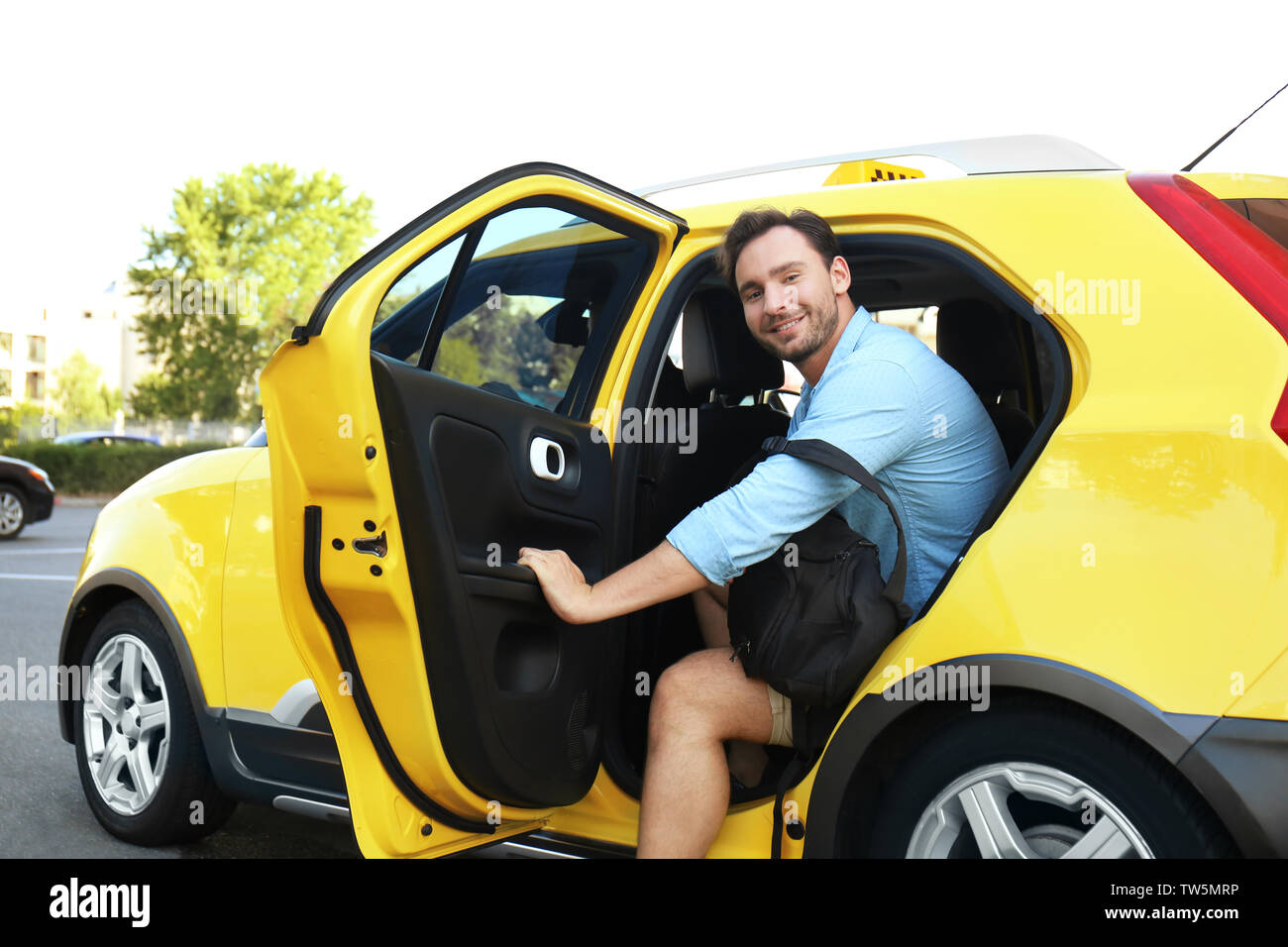 Young man in taxi car - Stock Image