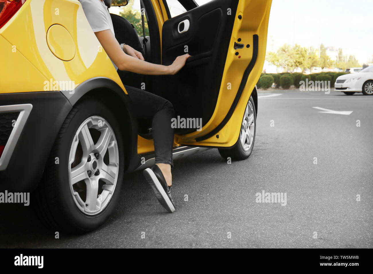 Young woman in taxi car - Stock Image