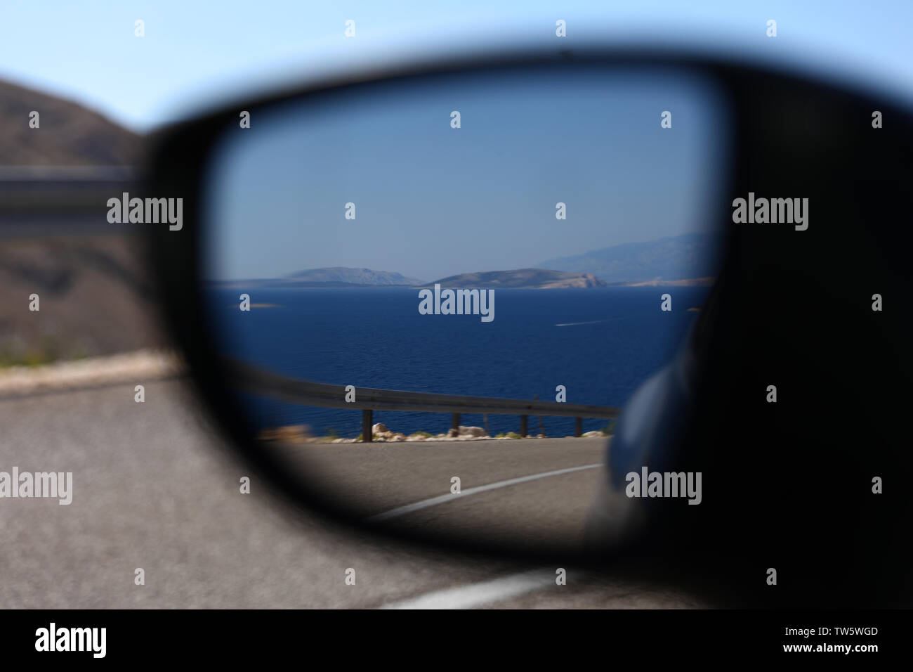 Picturesque view onto the marina via the auto mirror Stock Photo