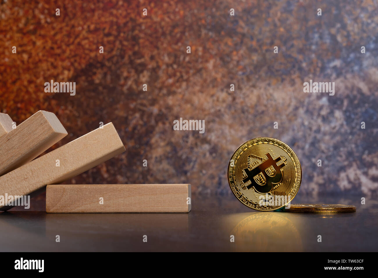 bitcoins fell down from domino blocks - Stock Image