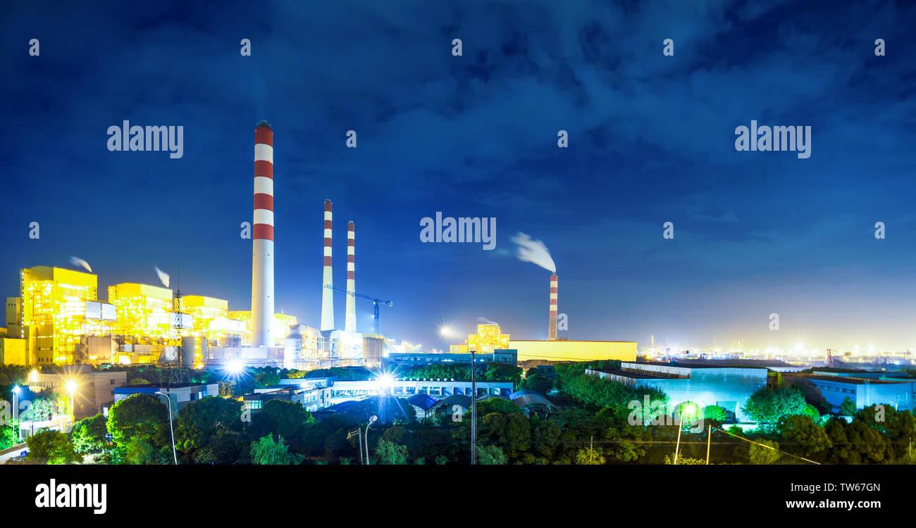 illuminated power station - Stock Image