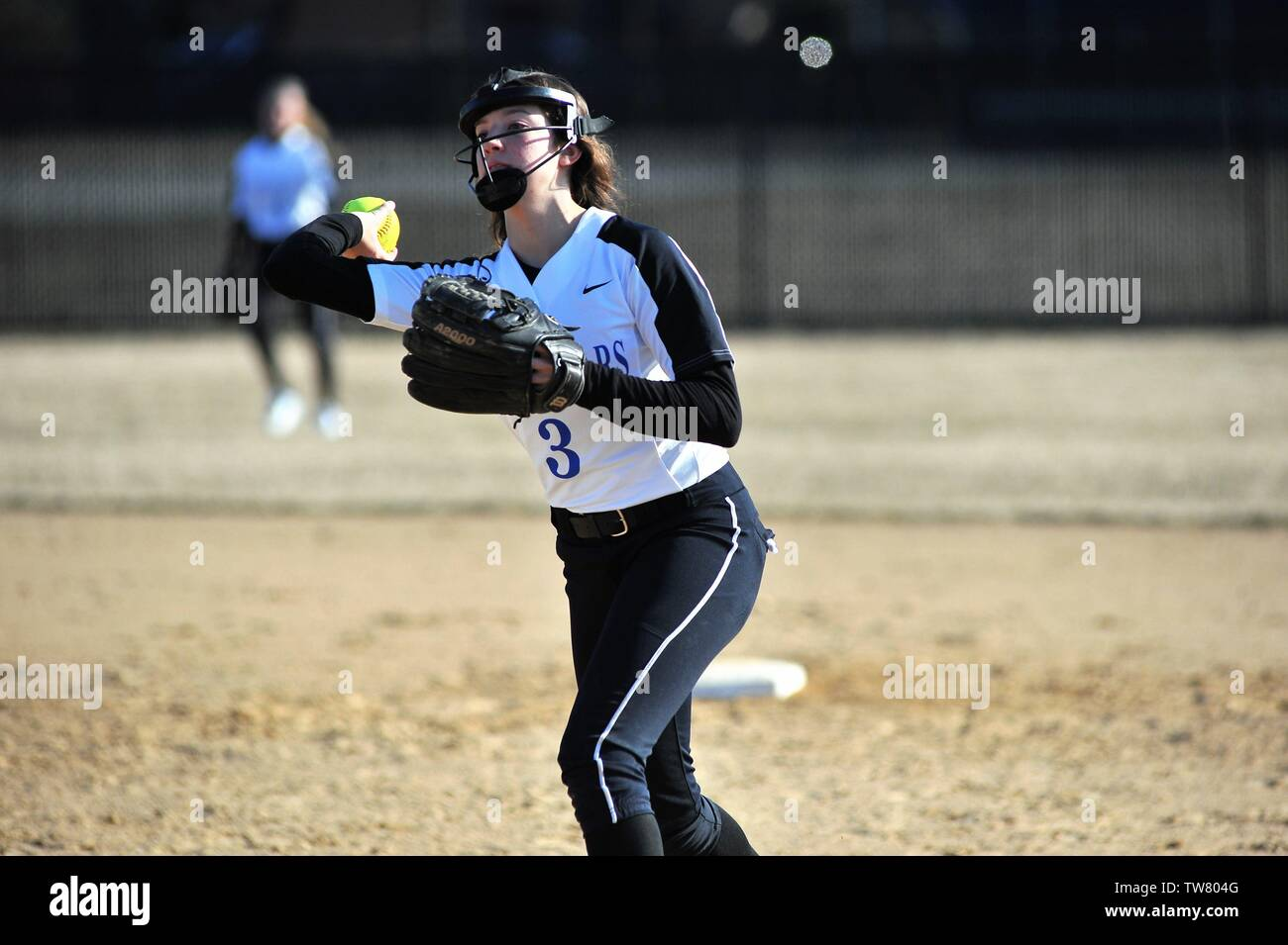 Second baseman throwing out an opposing batter after fielding a ground ball. USA. - Stock Image
