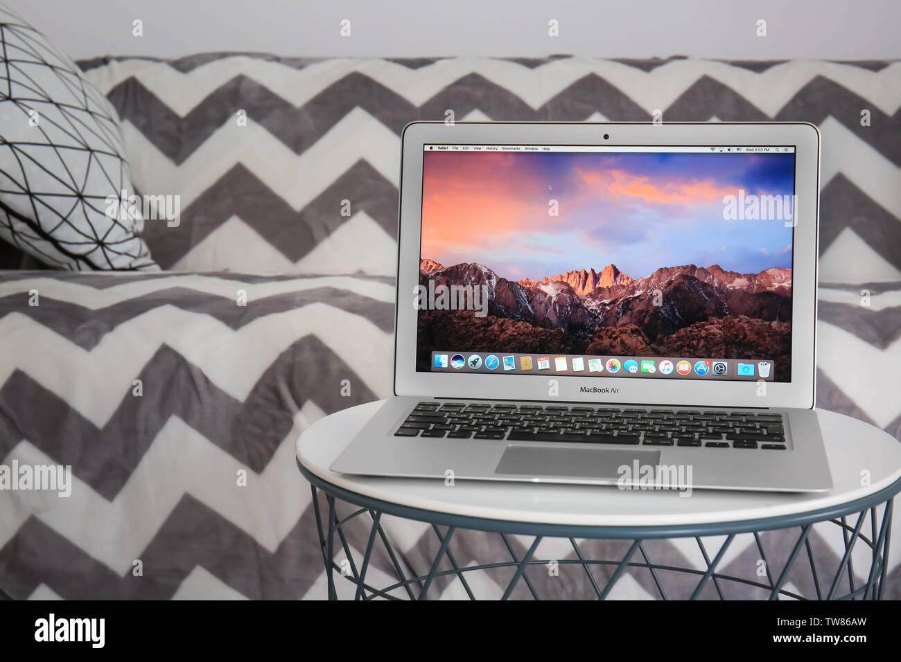 KYIV, UKRAINE - OCTOBER 18, 2017: Apple MacBook Air Silver with desktop screensaver on table indoors Stock Photo