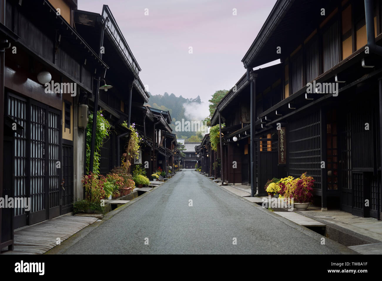 Kami-Sannomachi, old town street of Takayama city in early morning. Kamisannomachi is merchant town street lined with shops and restaurants - Stock Image