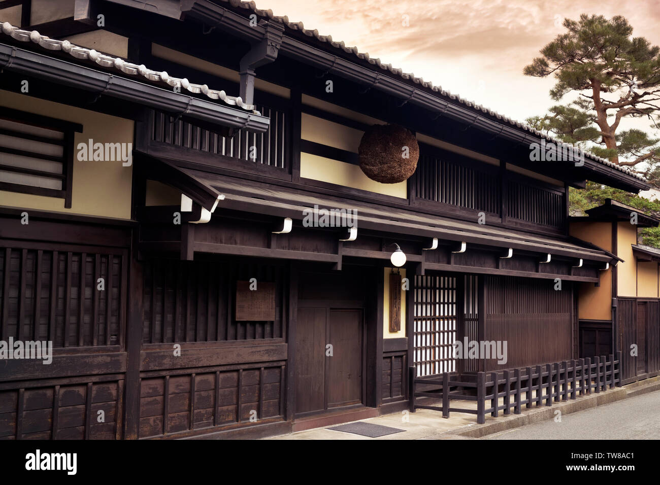 Sake brewery in Takayama old town with a Sugidama, cedar ball, hanging above the entrance. Japan travel photography, Takayama, Gifu prefecture, 2018. - Stock Image