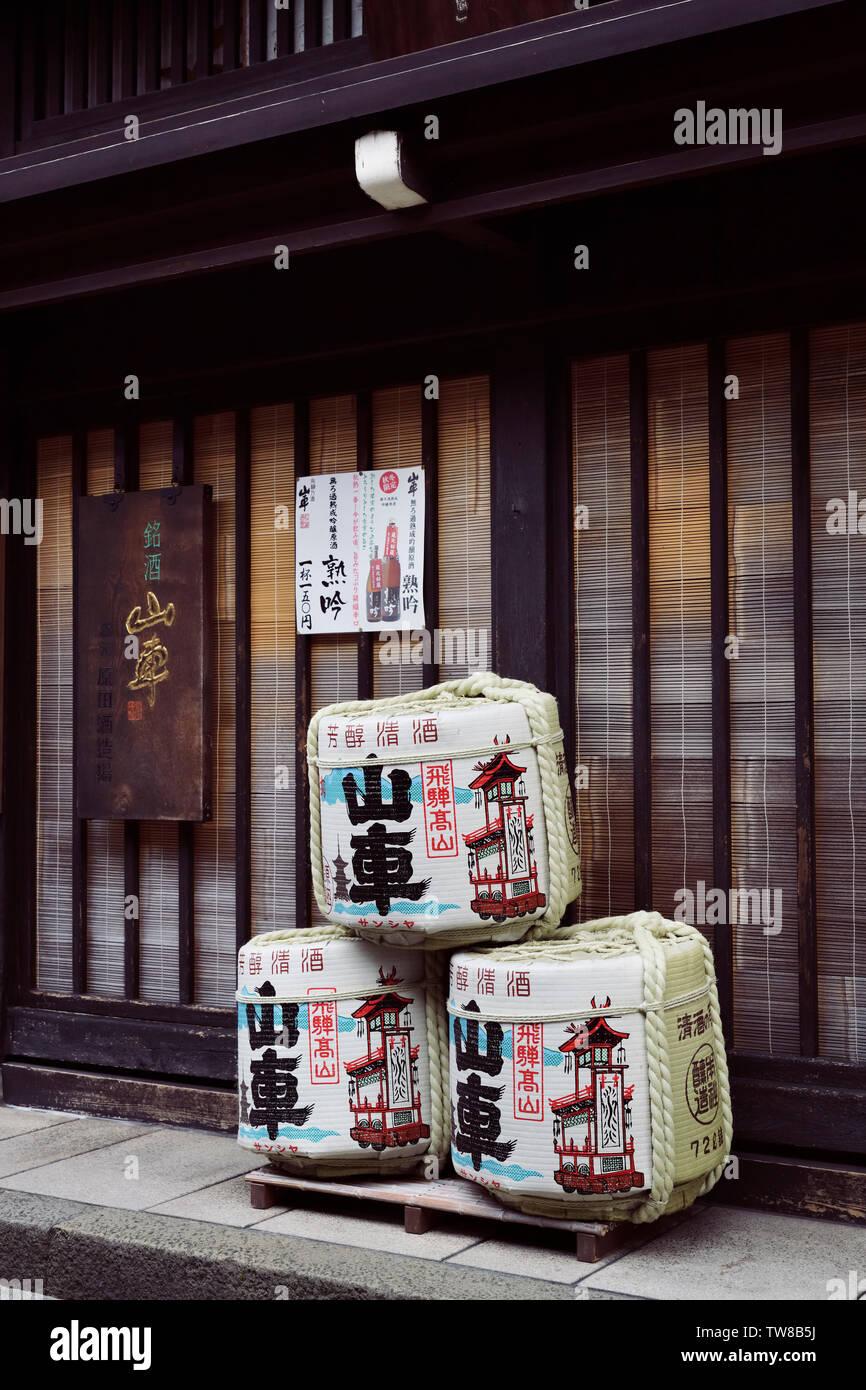 Kazaridaru, sake barrels, symbolic rice wine casks, Shinto symbol, outside of a sake brewery shop in Takayama old town. Japan Stock Photo