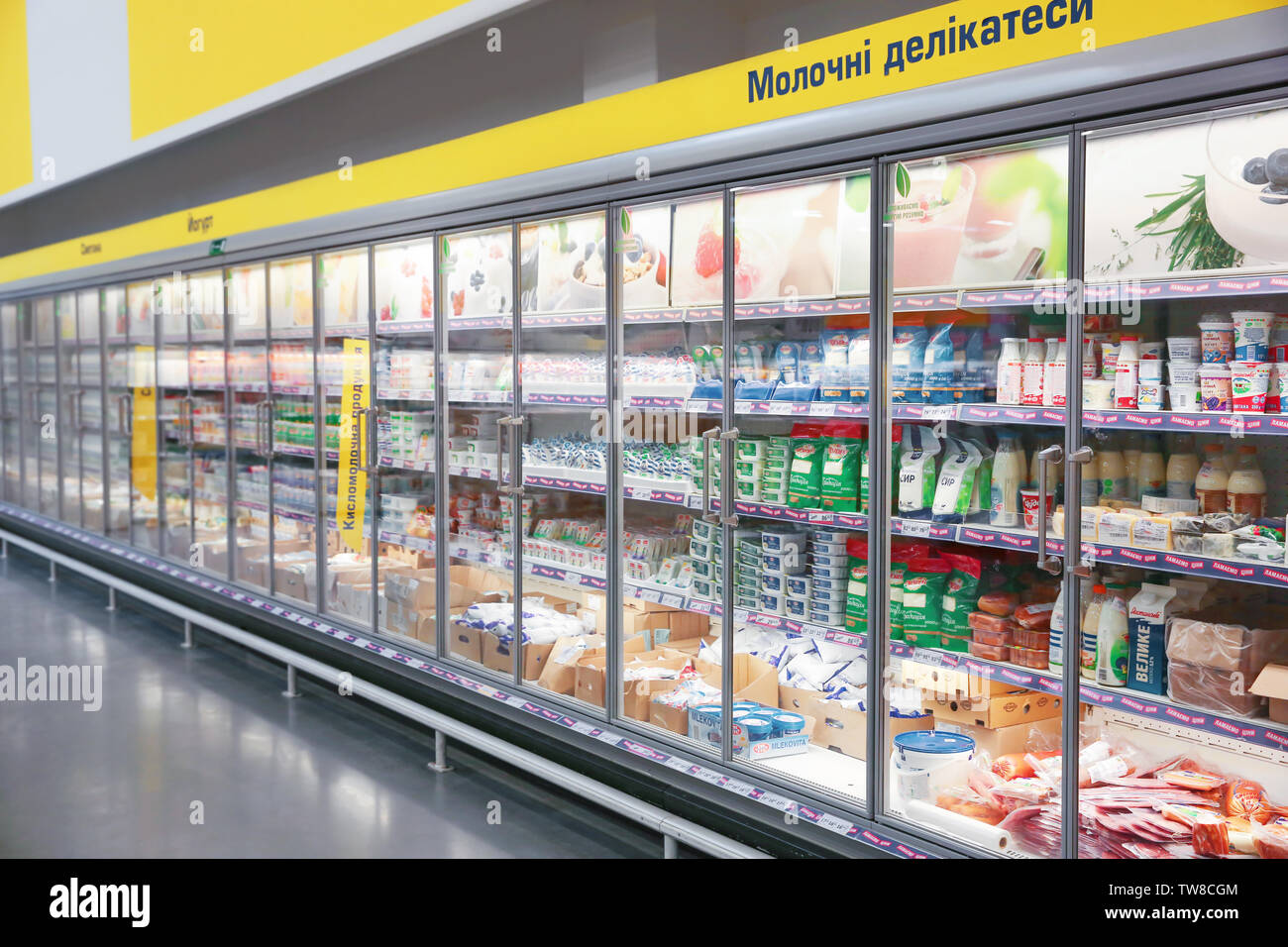 MYKOLAIV, UKRAINE - October 31, 2017: Cooling shelves with dairy products in hypermarket METRO - Stock Image
