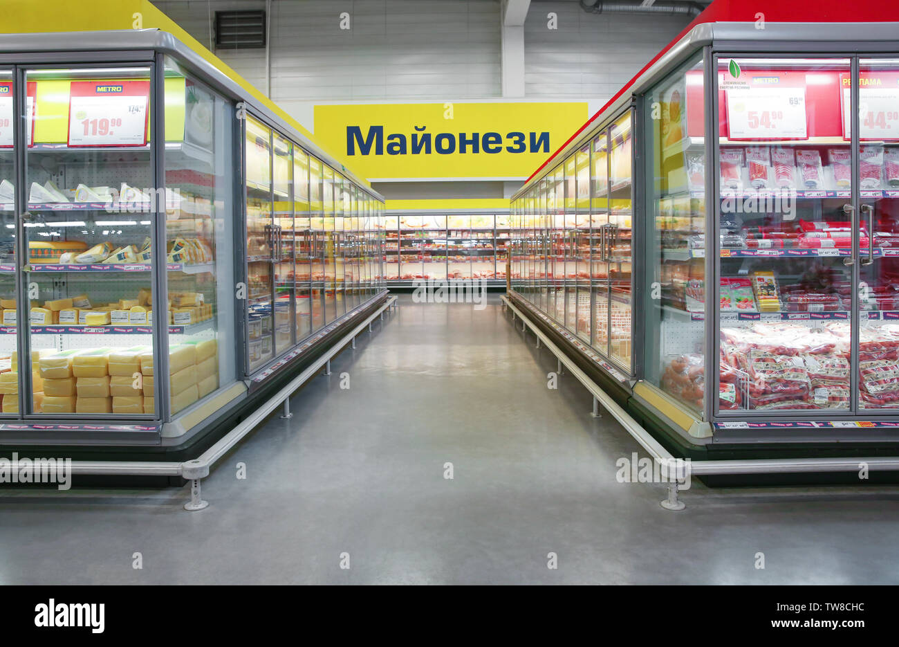MYKOLAIV, UKRAINE - October 31, 2017: Cooling shelves with dairy and sausage products in hypermarket METRO - Stock Image