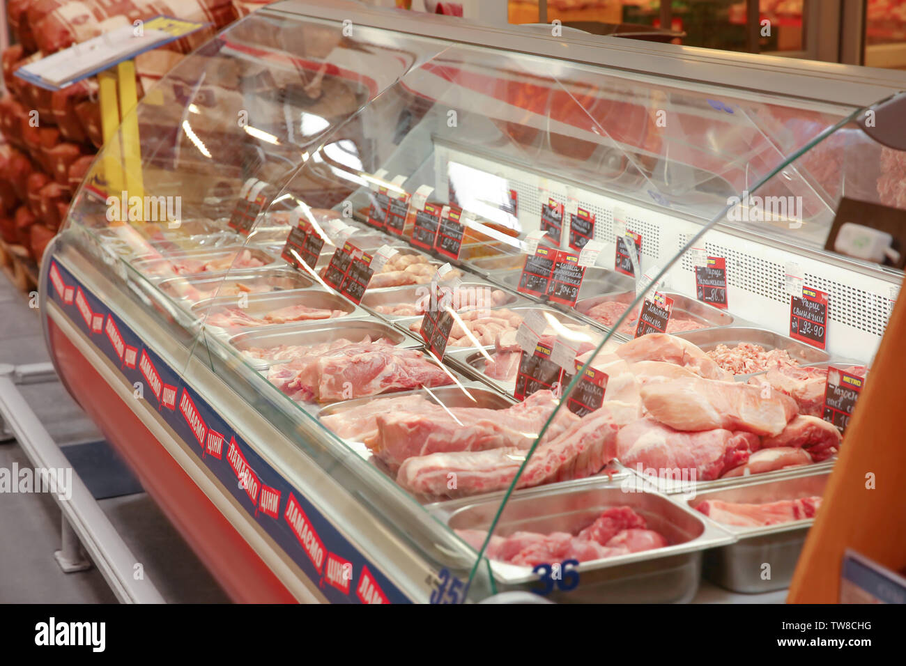MYKOLAIV, UKRAINE - October 31, 2017: Refrigerated display case with fresh meat products in hypermarket METRO - Stock Image