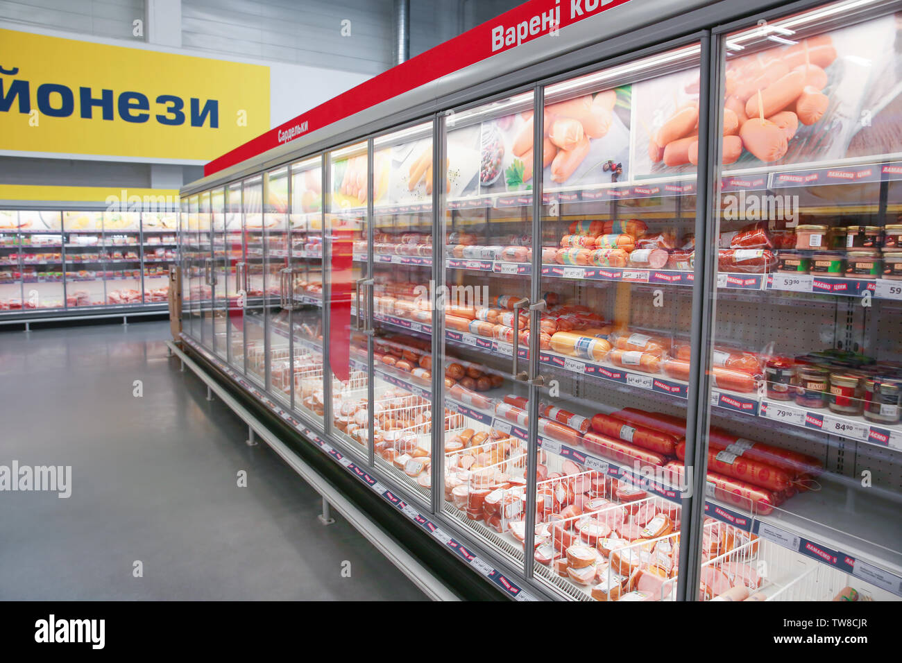 MYKOLAIV, UKRAINE - October 31, 2017: Cooling shelves with sausage products in hypermarket METRO - Stock Image