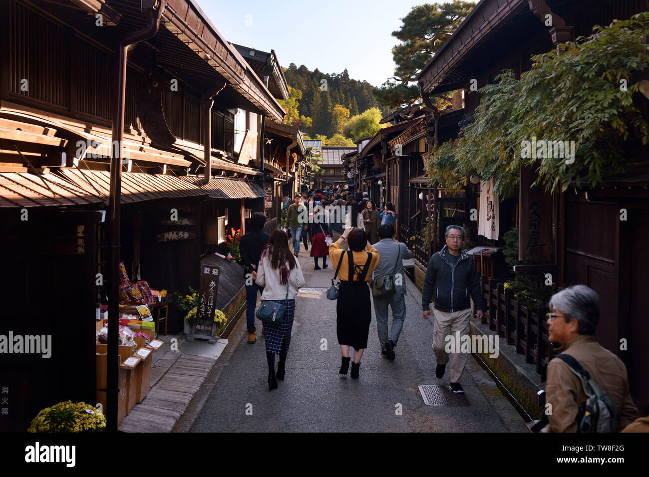 Busy with tourists Kami-Sannomachi, old town market street of Takayama. Merchant town street lined with shops and restaurants. Japan Stock Photo