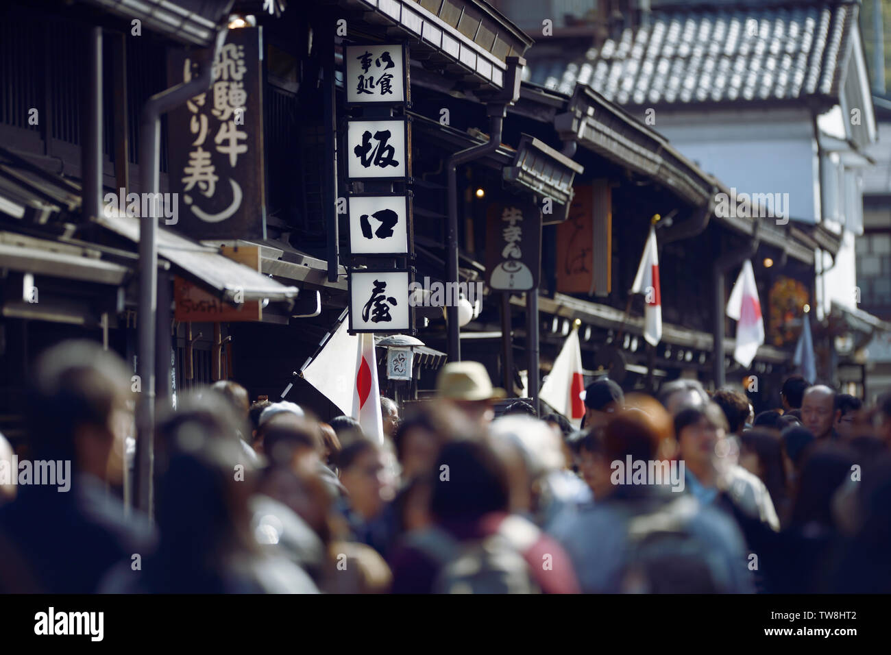 Artistic scenery of busy with tourists Kami-Sannomachi, old town market street of Takayama city on a public holiday, Culture day. Hida-Takayama, Gifu Stock Photo