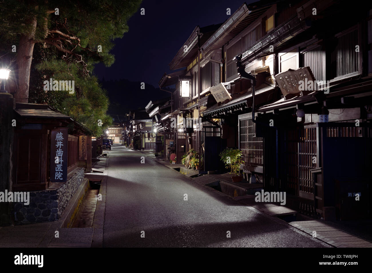 Kamisannomachi, old town in Takayama city at night with lit up street lights and shop signs. Hida-Takayama, Gifu prefecture, Japan travel photography - Stock Image