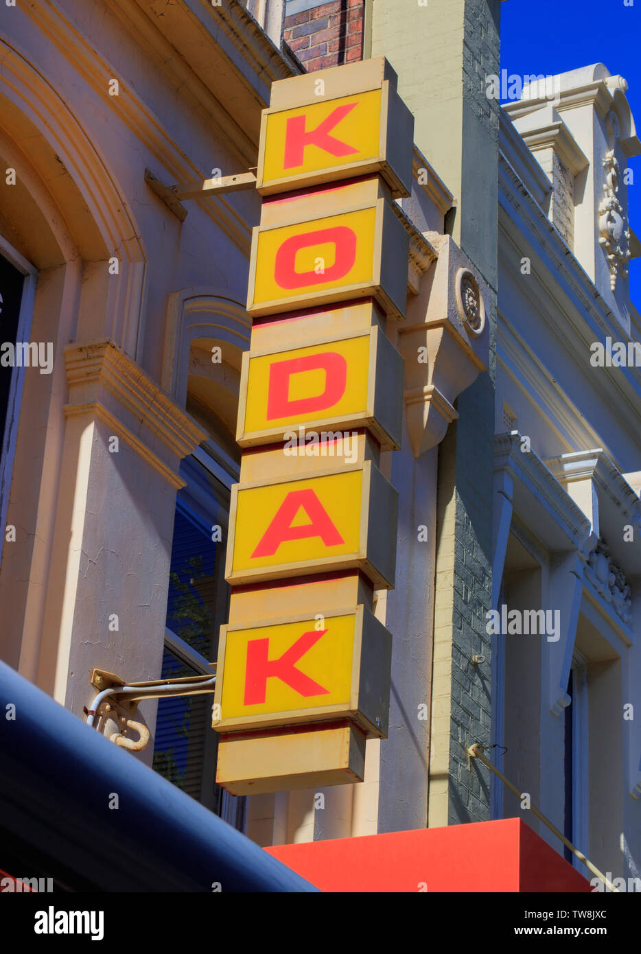 Retro Kodak sign above a store in Launceston Tasmania.   Kodak film company once dominated the film and camera industry but failed to manage digital r - Stock Image