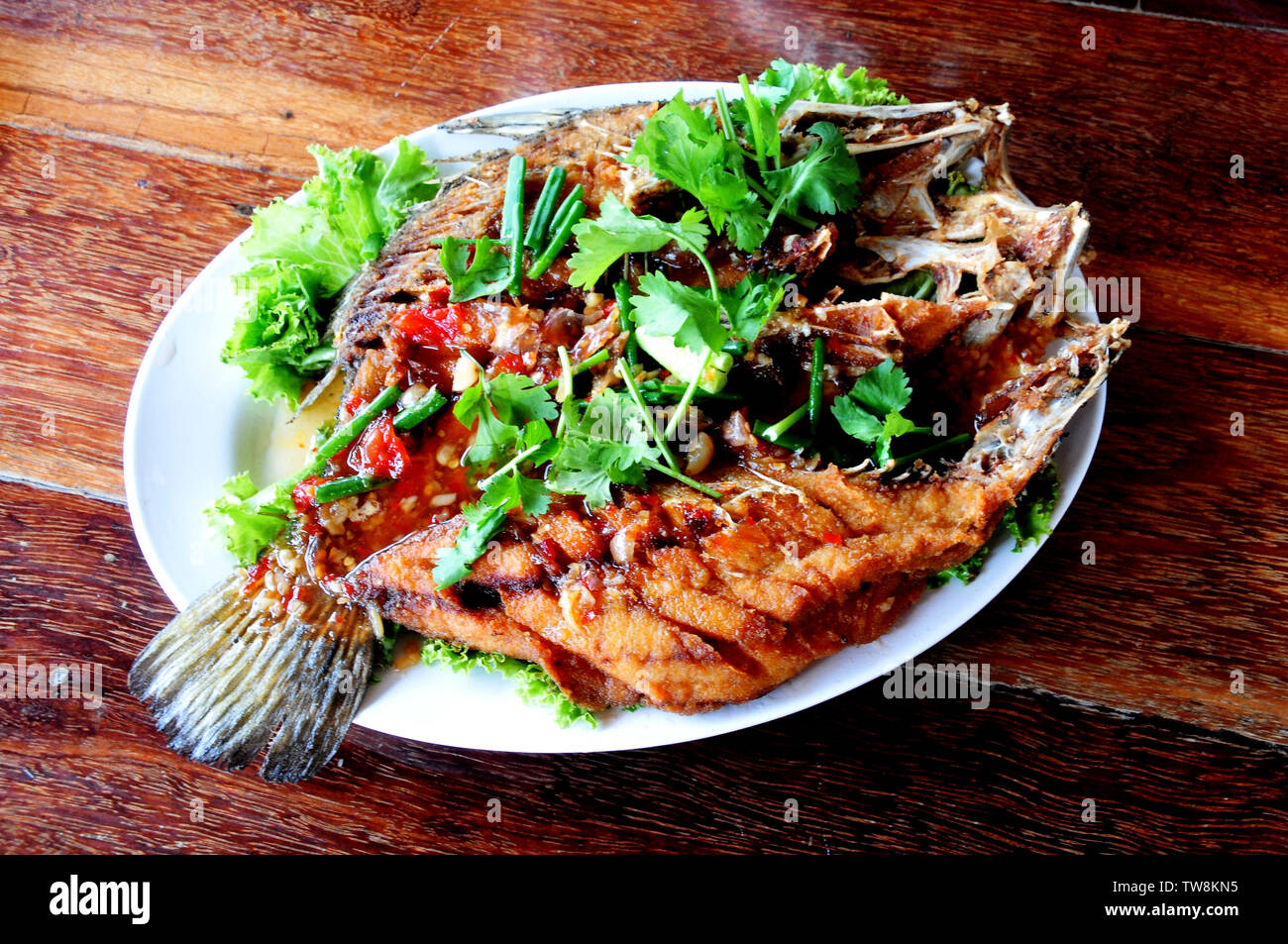 Fried Fish With Sweet Chili Sauce Recipe Pla Rad Prik Stock Photo Alamy