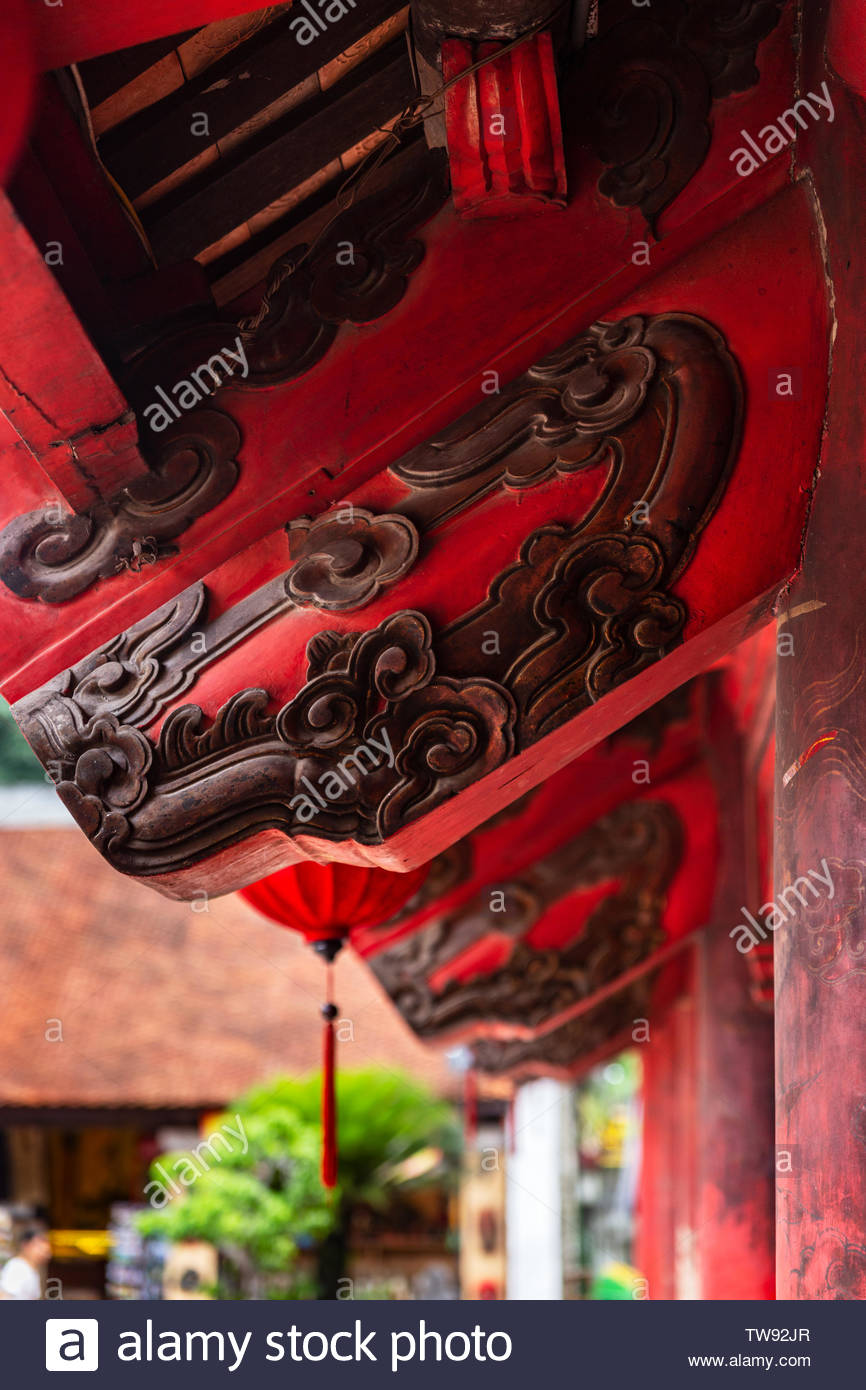 Roof wooden red beam with traditional black engravings close-up in the Temple of Literature, Hanoi, Vietnam. Stock Photo