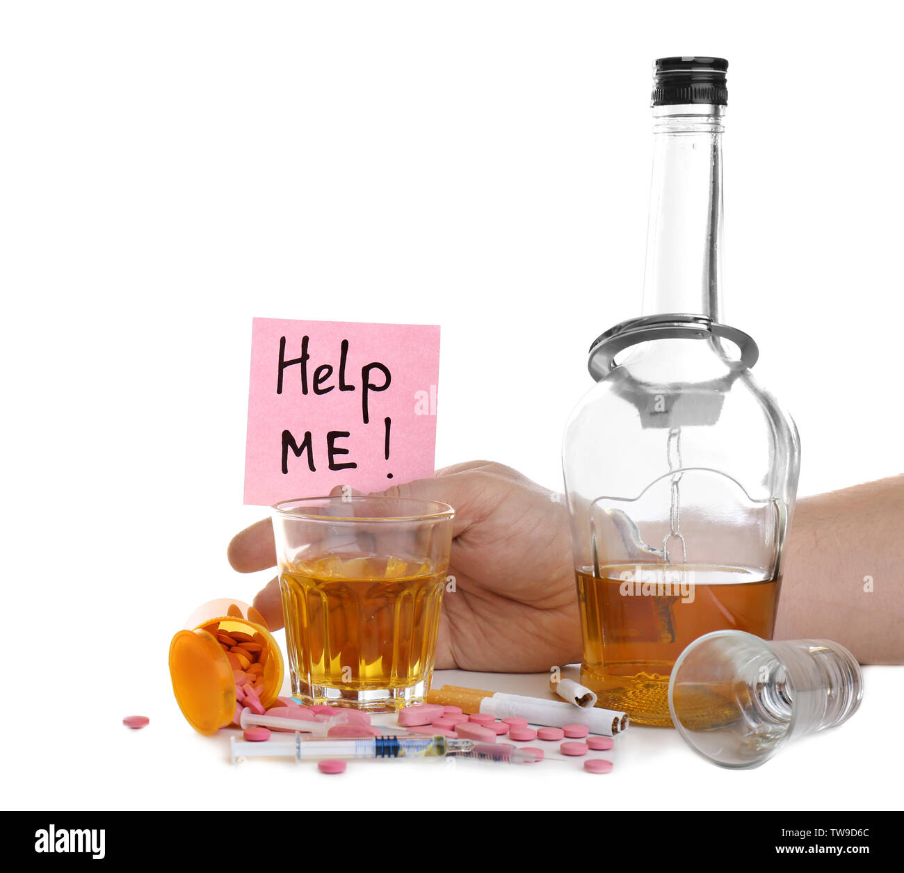 Man in handcuffs holding note with words 'Help me' near alcohol, cigarettes and drugs on white background - Stock Image