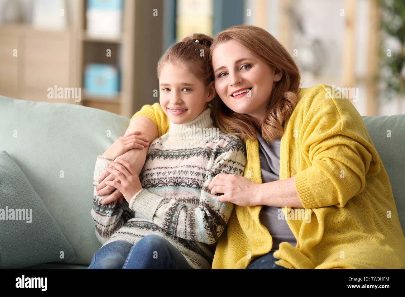 Portrait of happy mother and daughter at home - Stock Image