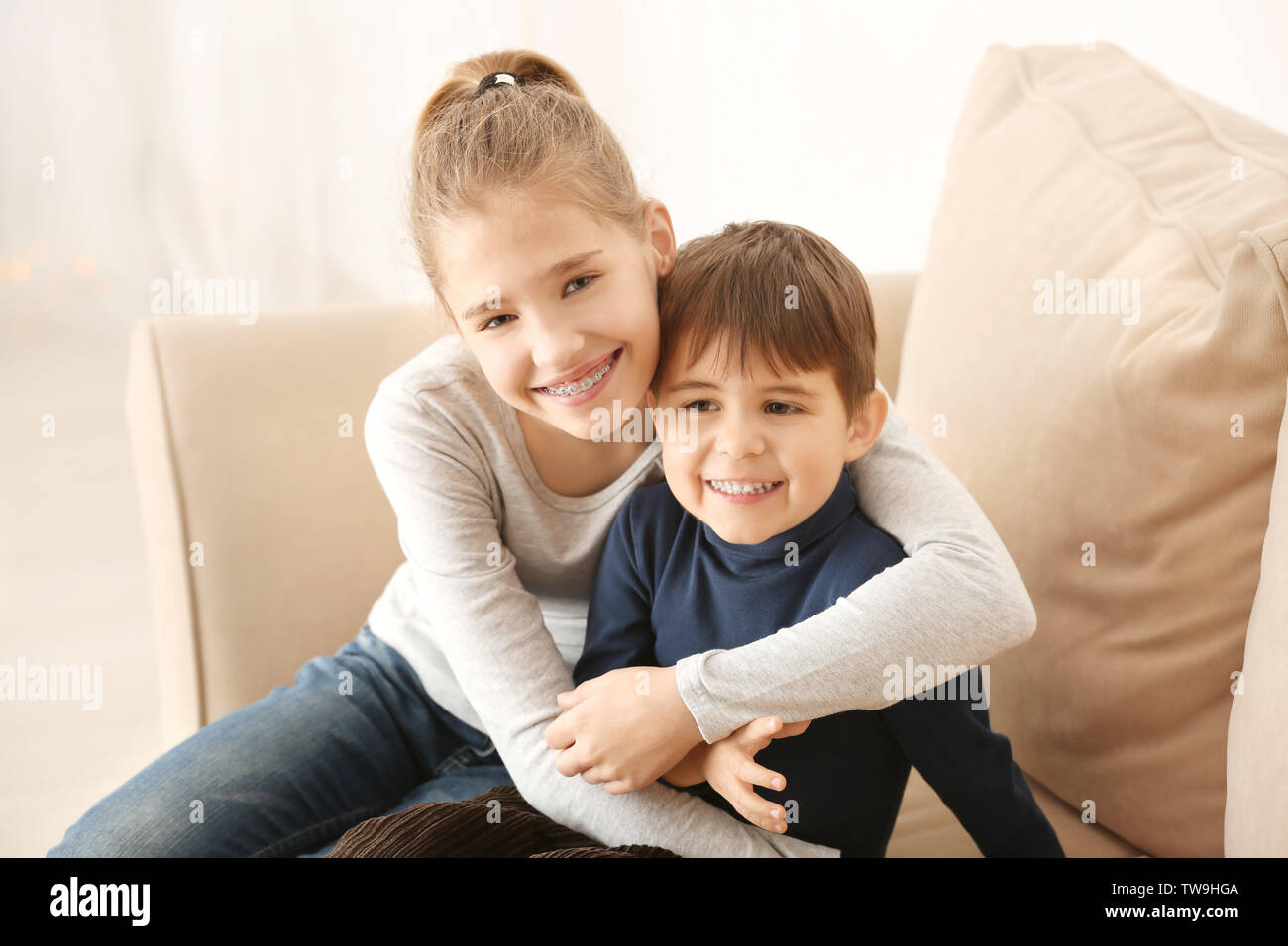 Portrait of cute little children at home - Stock Image