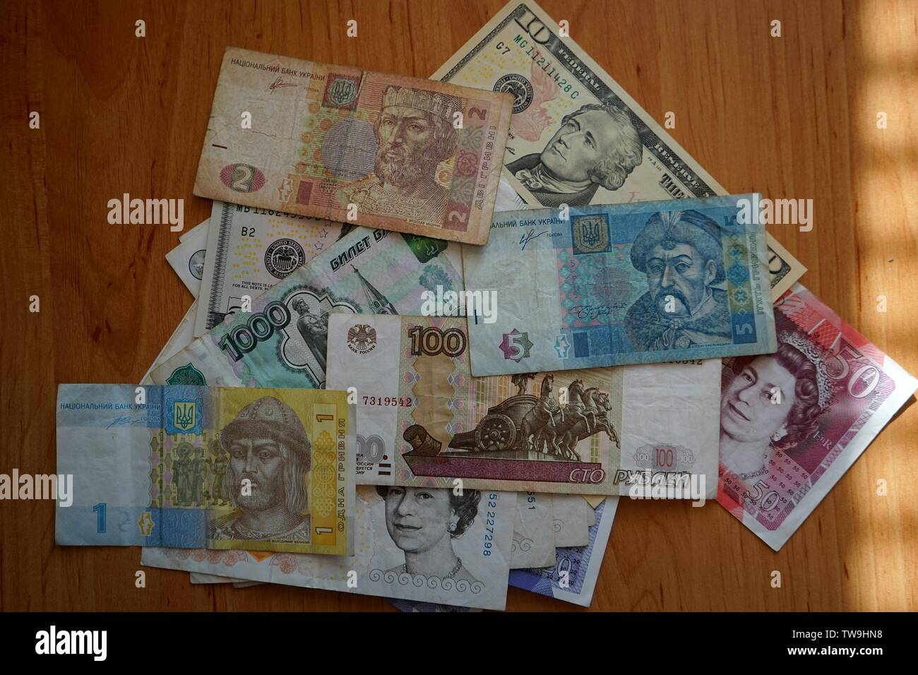 A small selection of world currencies, rubles, hryvnias, dollars and pounds. - Stock Image