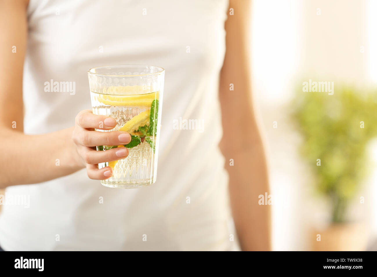Young woman with glass of fresh lemonade, closeup - Stock Image