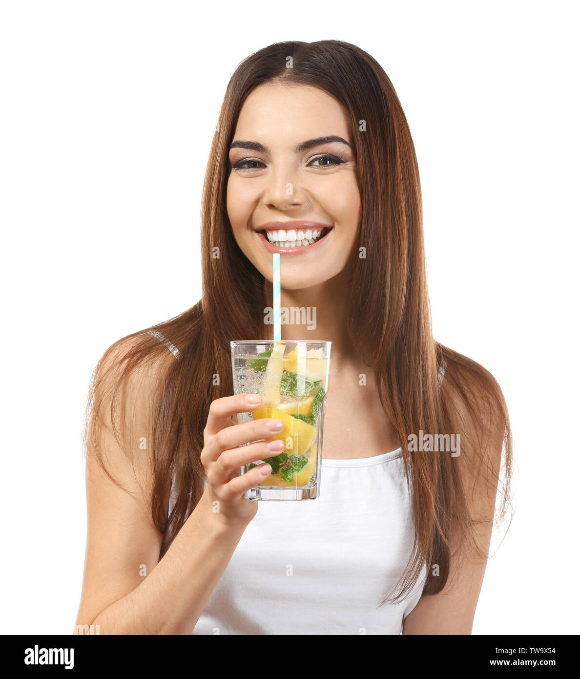 Beautiful young woman drinking lemonade on white background - Stock Image