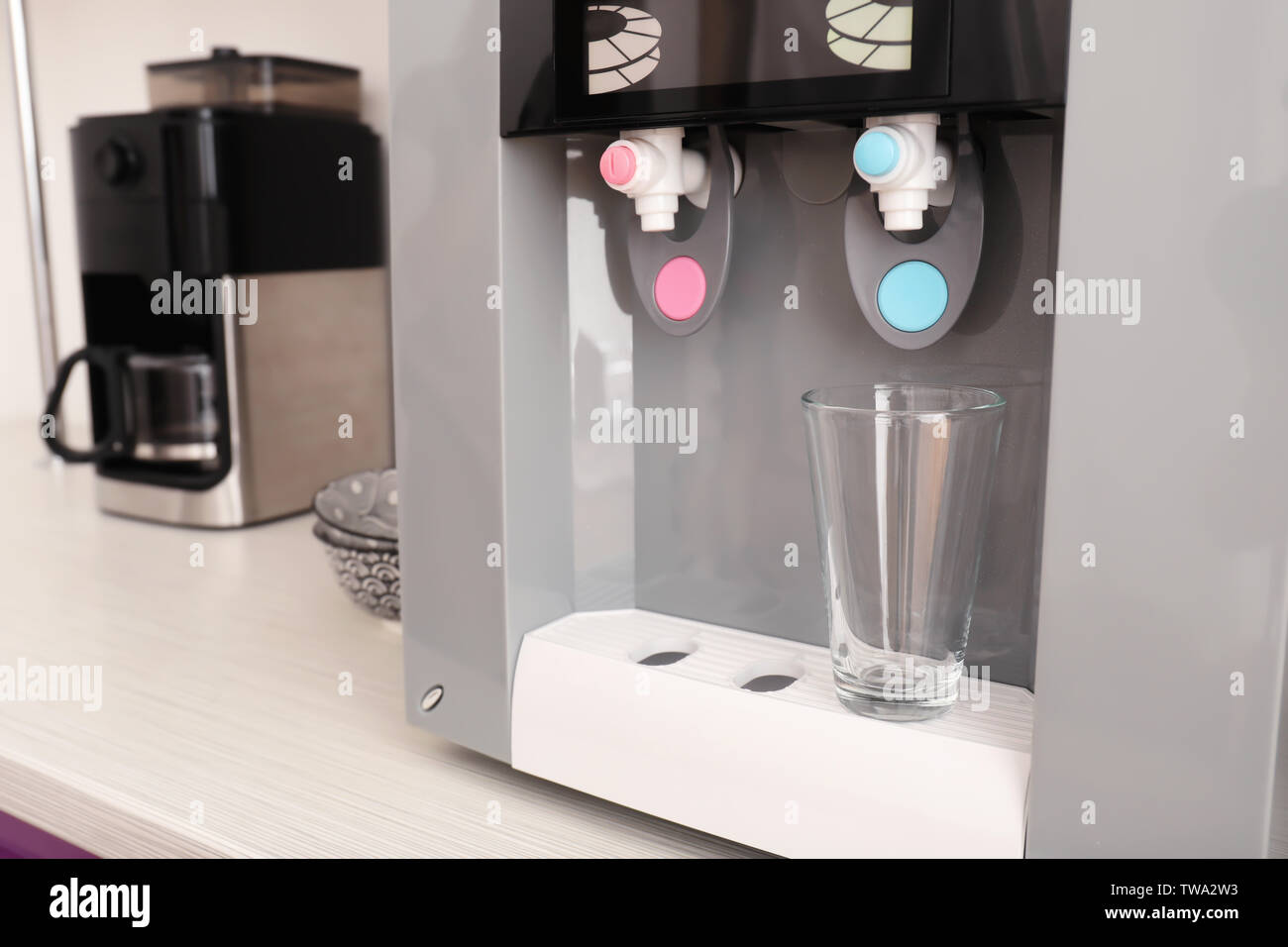 Office water cooler with glass, closeup - Stock Image
