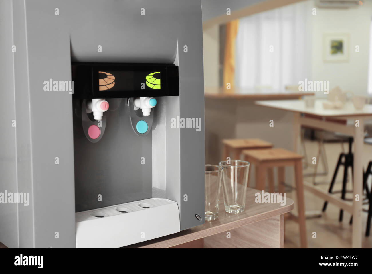 Office water cooler on table indoors - Stock Image