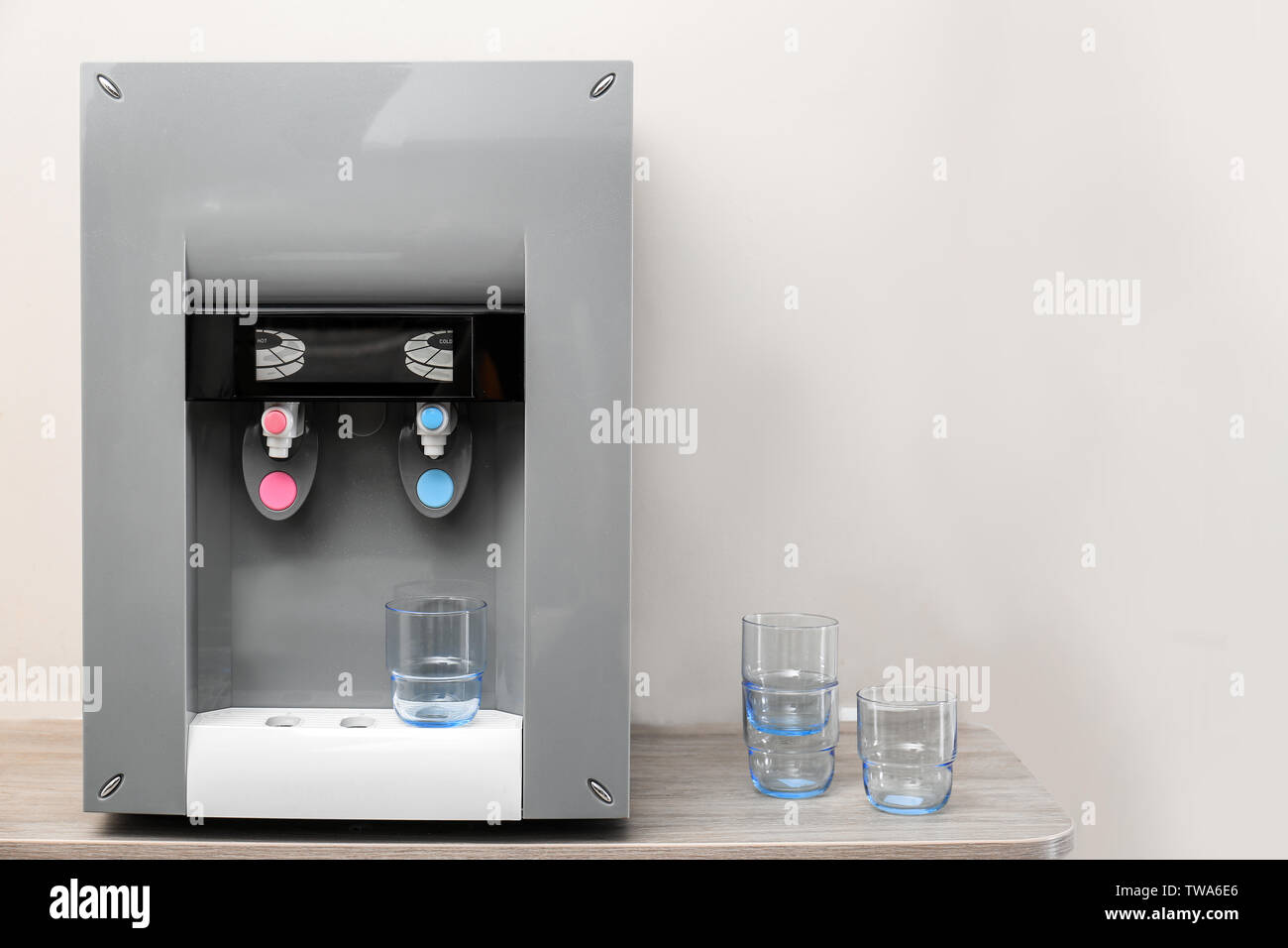 Water cooler on table indoors - Stock Image