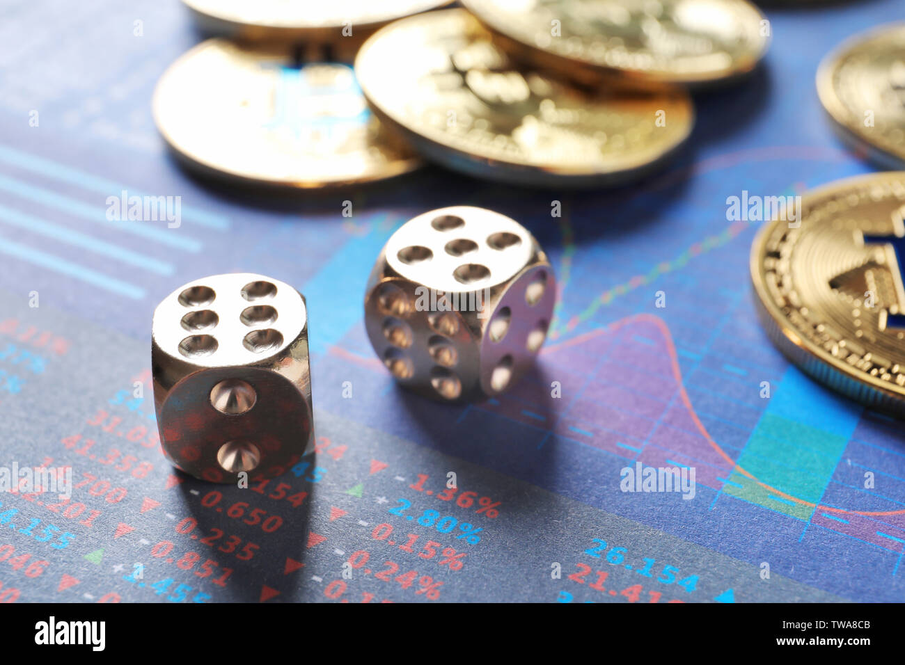 Dice and golden bitcoins on chart. Finance trading - Stock Image