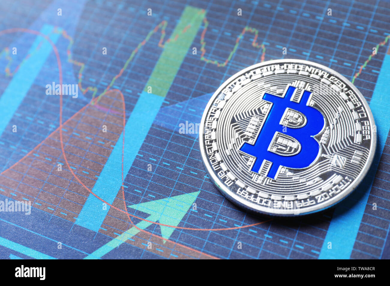 Silver bitcoin on chart. Finance trading - Stock Image
